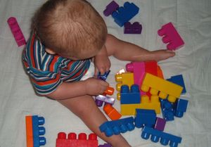 Baby_with_toys_2